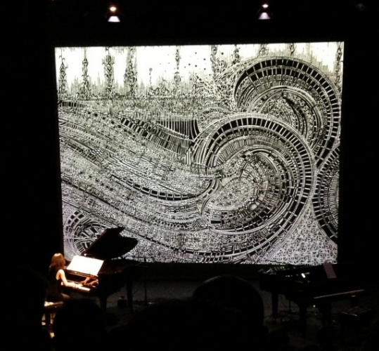 Izumi Kimura performing Impressions De La Mer - Movement 1 at The Samuel Beckett Theatrewith Movement 2 projected in the background.