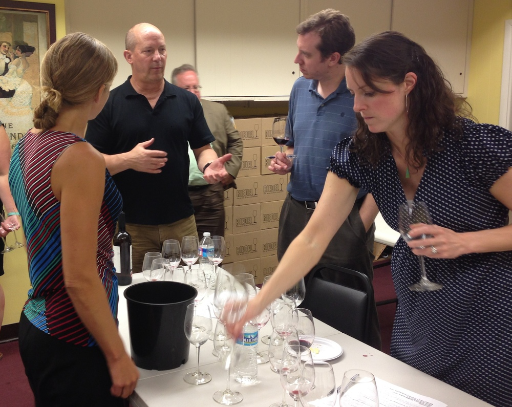 Wine expert Michael Franz chats with students after class