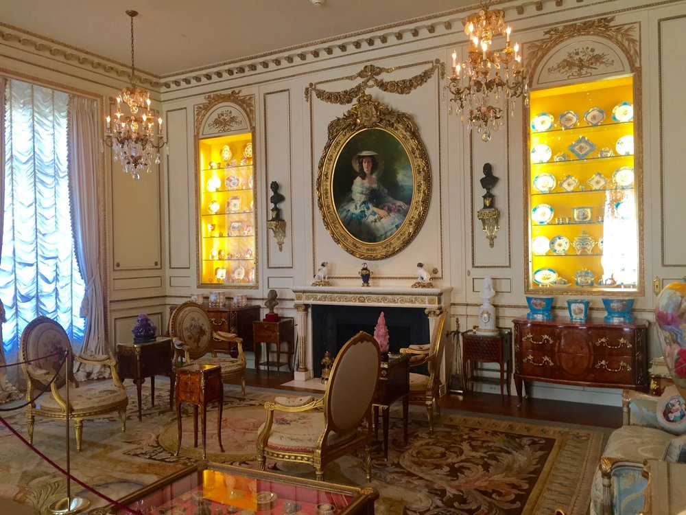 A dinner party at Hillwood began in the French Drawing Room, where you enjoyed a cocktail, strolled out to the gardens, and were invited by Marjorie Post to touch, sit in, and enjoy her 18th-century French furniture and art.