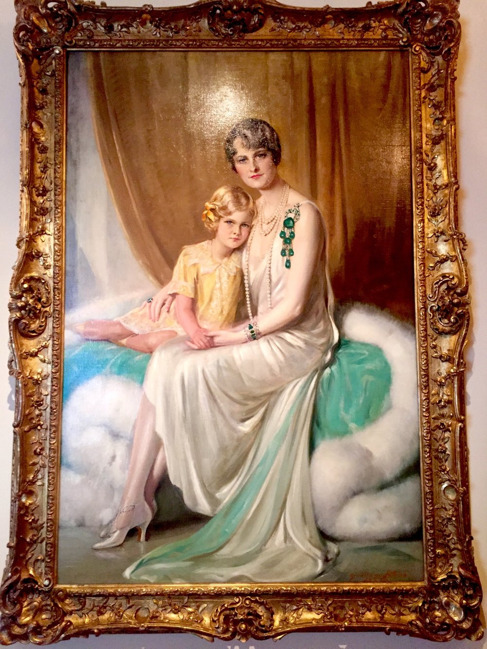 Post and daughter, Nedenia. Nedenia will grow up to become actress Dina Merrill. The emerald brooch by Cartier will be part of the Spectacular exhibit.