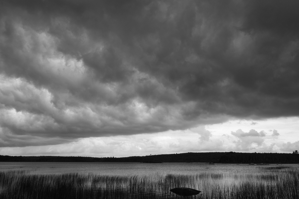 a storm passing over the edge of the lake