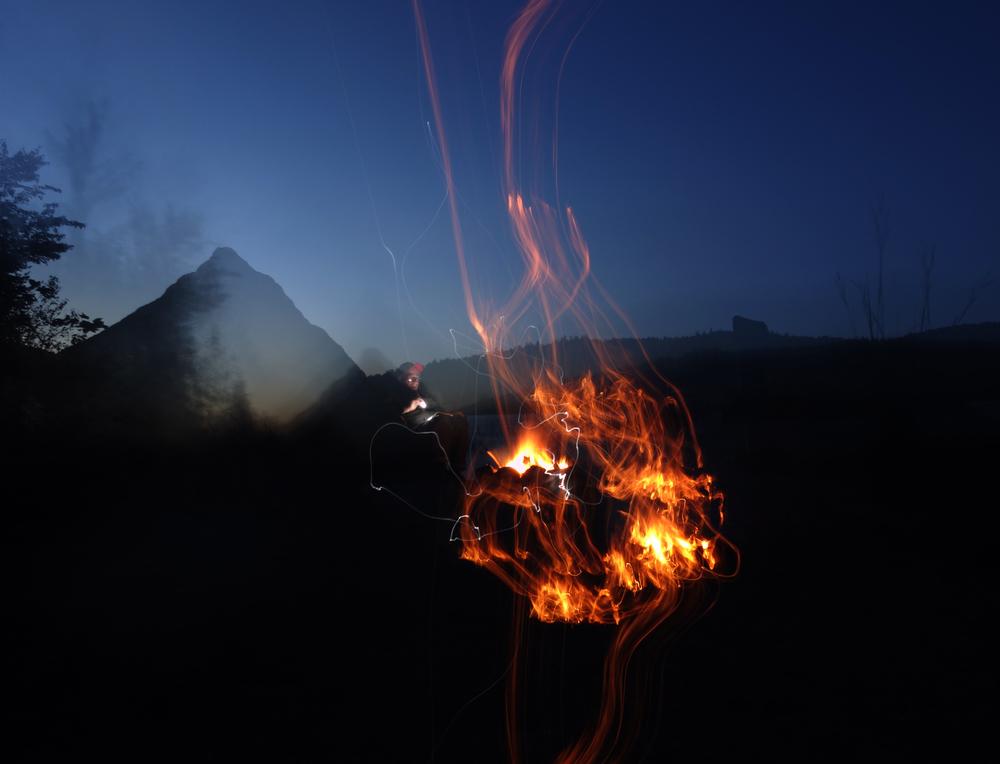 a shaky long exposure of a campfire