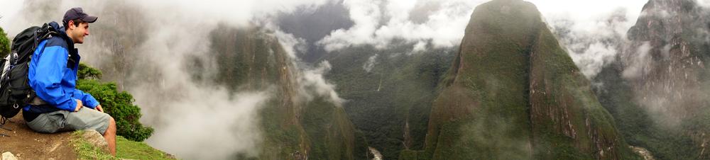 Evan Karge sitting on an Incan wall