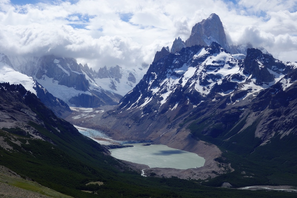 The Fitz Roy's peak visible through a break in the clouds