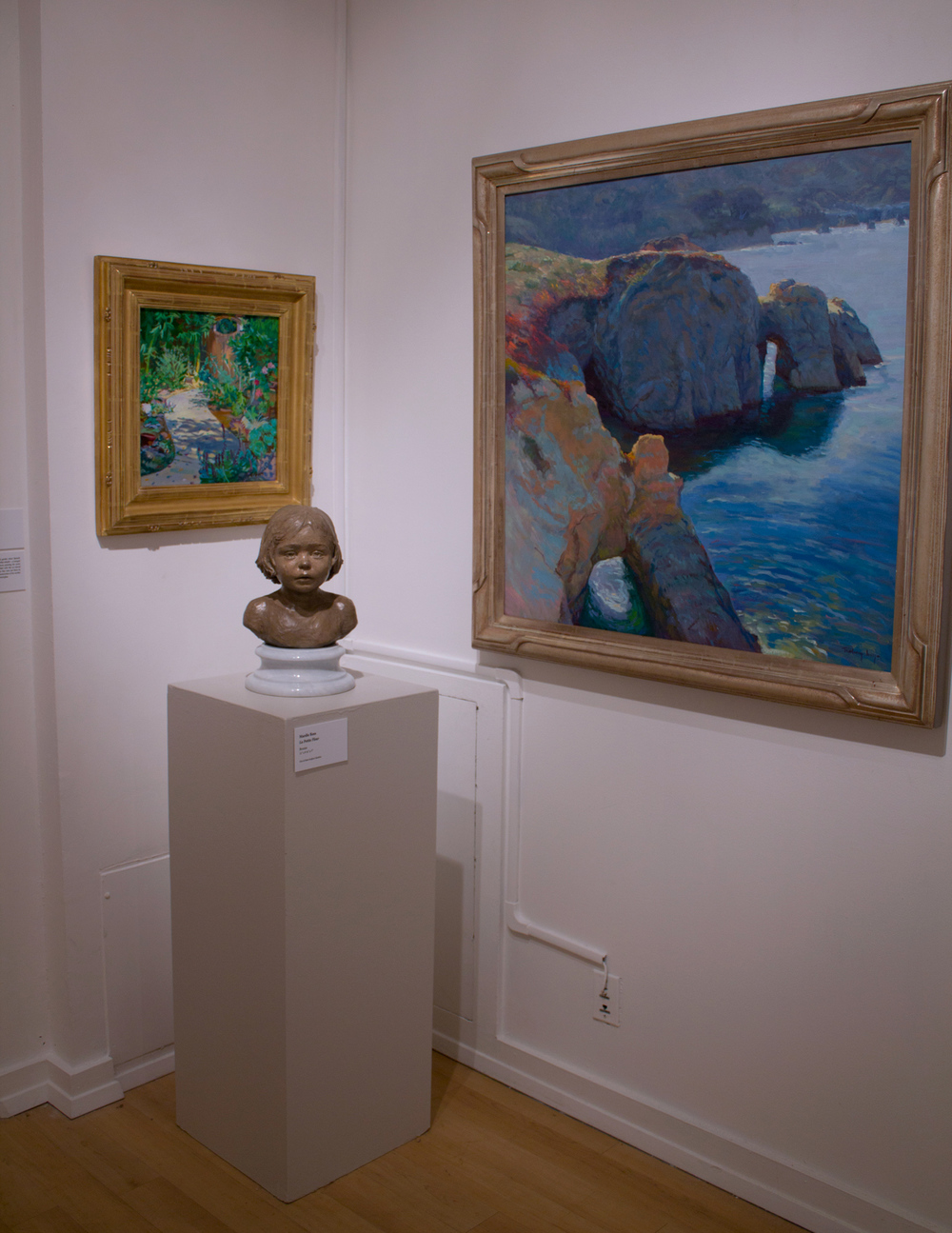 """La Petite Fleur"" shown next to two landscape paintings."