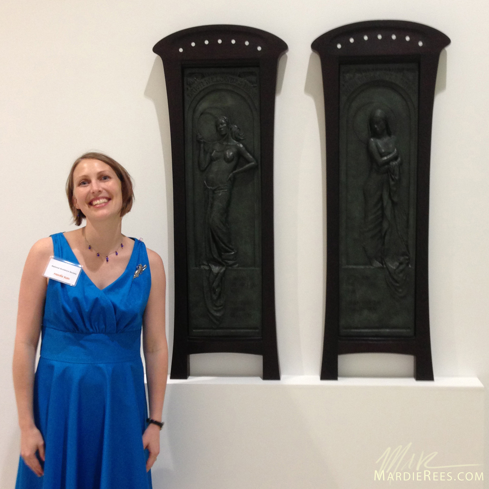 "Mardie Rees standing next to ""Dawn & Dusk"" on the night of the opening reception."