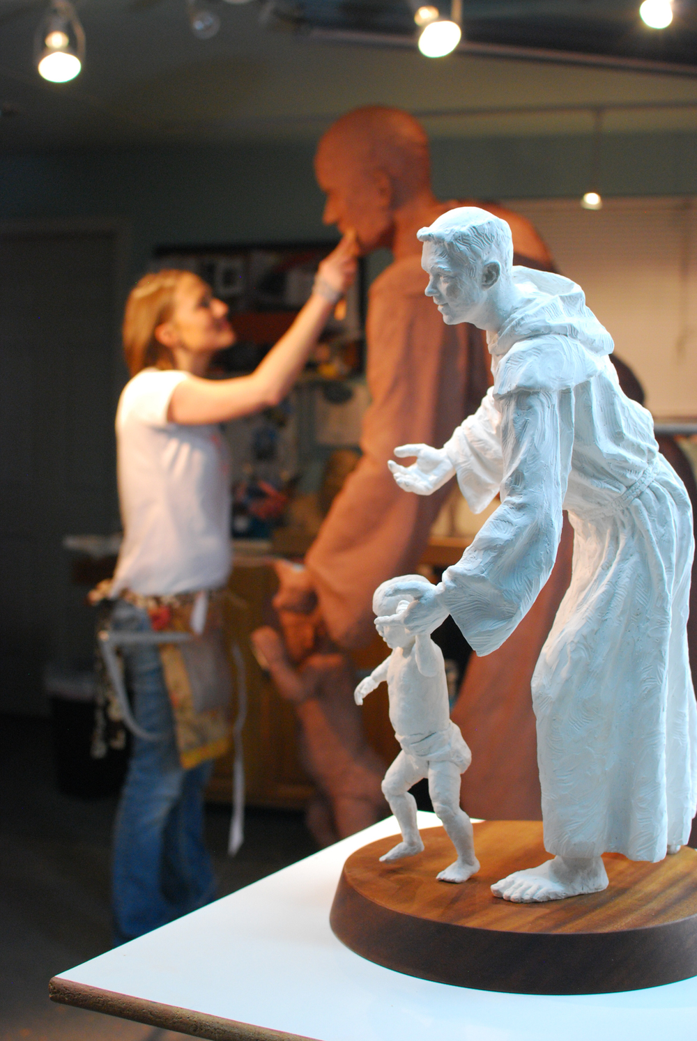 Mardie sculpting, with finished maquette in foreground