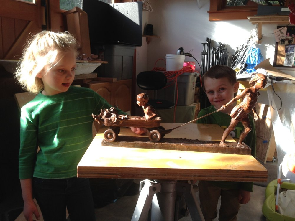 My kids, Jasmine and Adam, taking a closer look at the finished bronze sculpture.