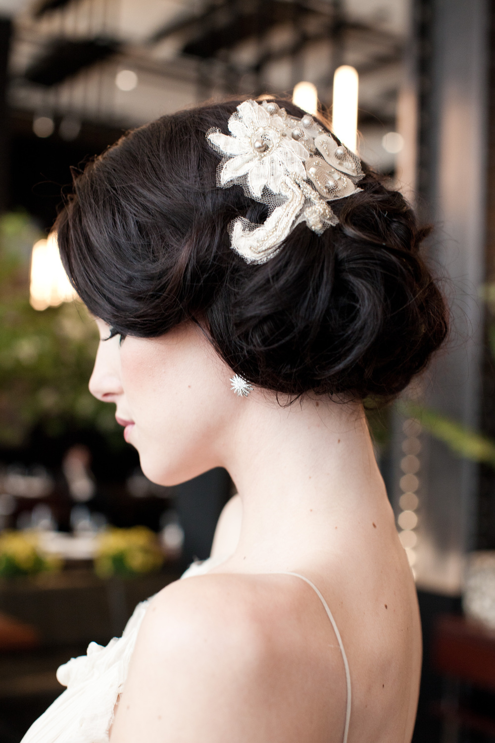 T his custom piece incorporates vintage pearls and beads with lace from the gown. Photo by  Moss & Isaac