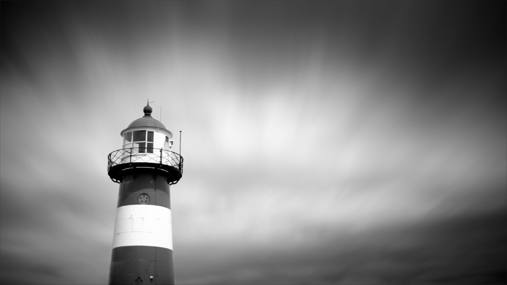 Composite of masked lighthouse and sky