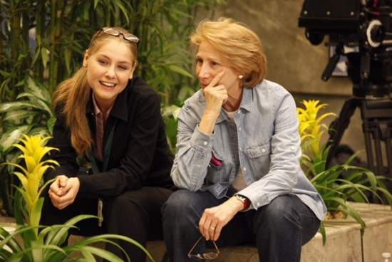 Producer Elizabeth Hemmerdinger, right, on set