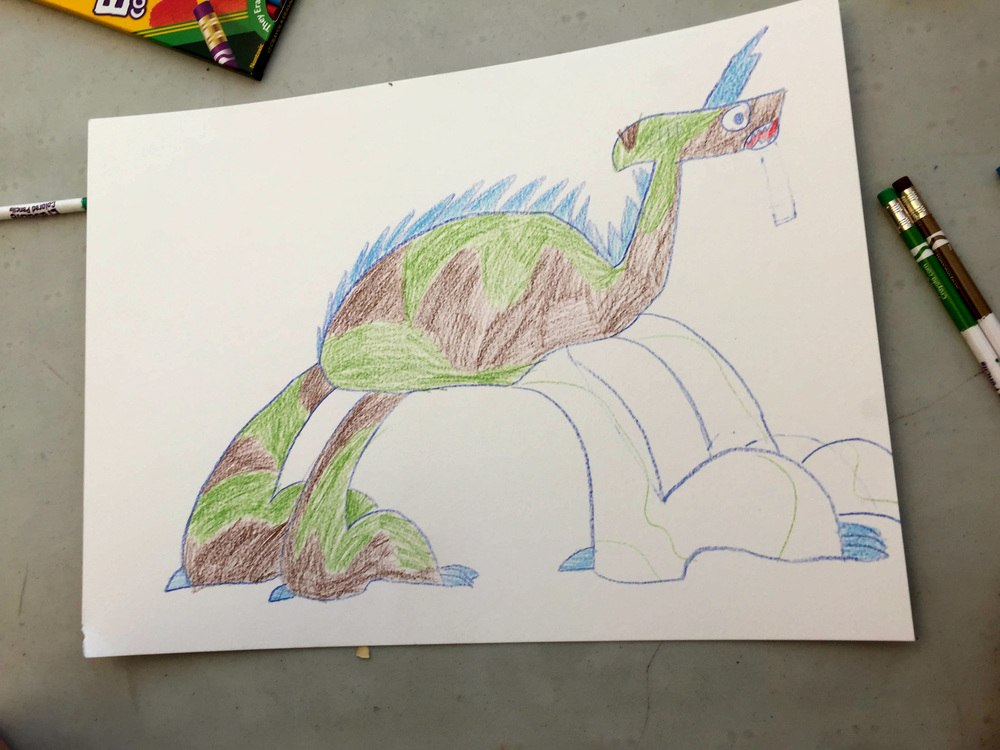 dinosaur drawn by john. i suggested leaving the front legs as is & not coloring them in, as it was visually more interesting.