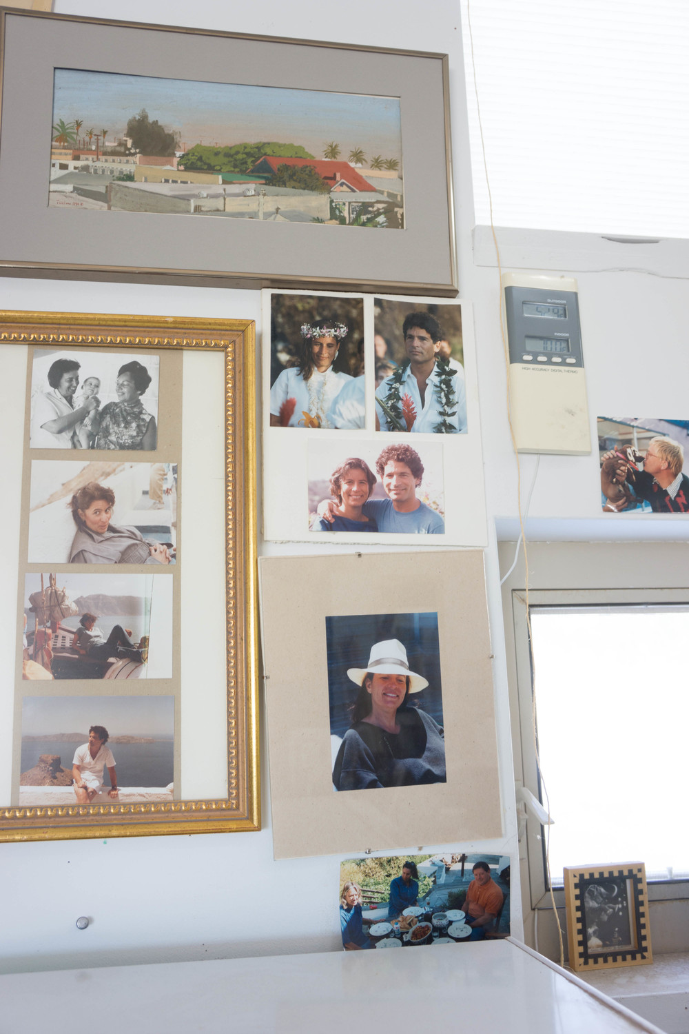 more family photos on a wall adjacent to my kitchen, plus one on the right of david hockney ca. 1980 with his daschund
