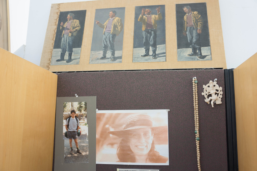 above my desk, mikela with hat; philip as a hiker & small oil panels of a greek fisherman