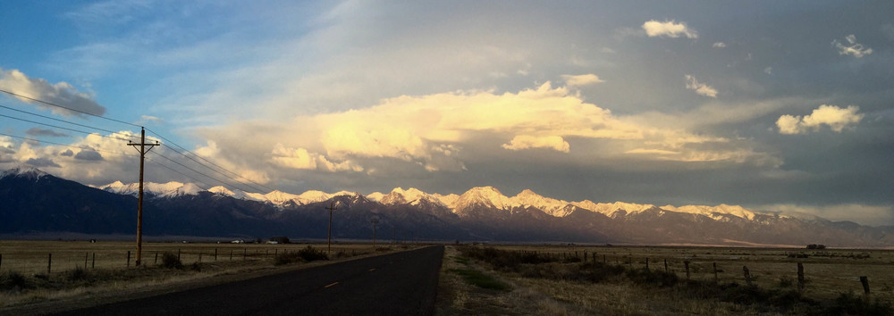 7:15 pm: 16 miles from  crestone . in the distance on far right: the great sand dunes national park. crestone is directly below the flat snow capped peak in the center