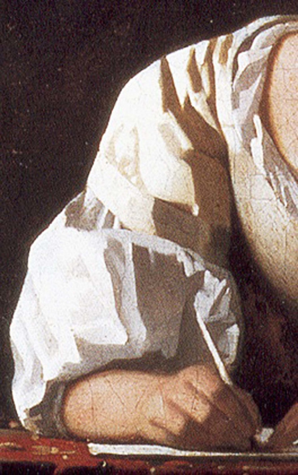 detail of a  vermeer  illustrating his particular genius in painting fabric and flesh.