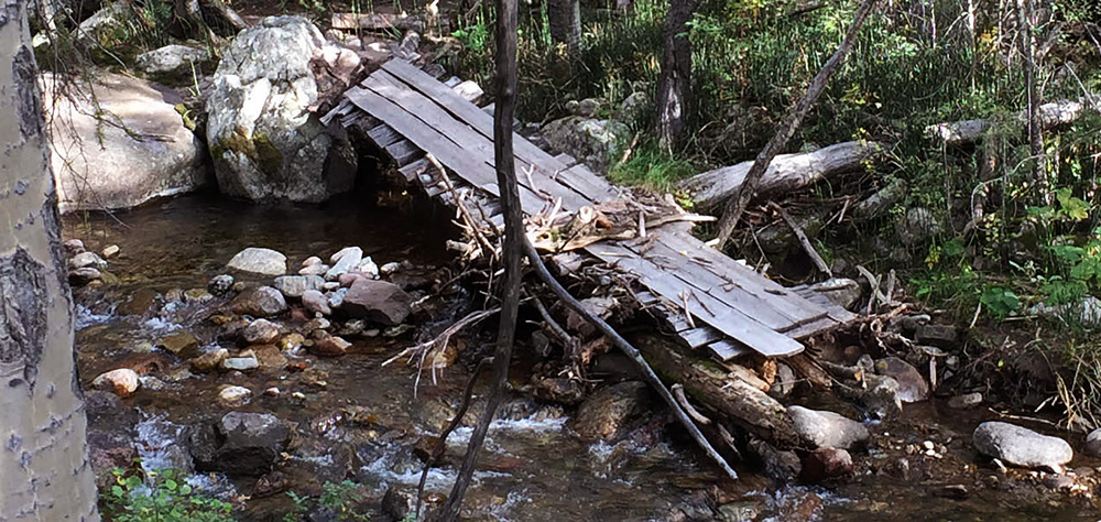 this past spring this bridge across the creek was swept away by flood waters and has yet to be rebuilt.