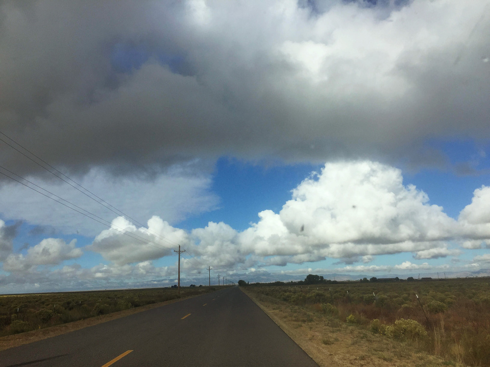 """leaving crestone this morning on the """"T road"""" clouds still hanging about from yesterday's rain."""