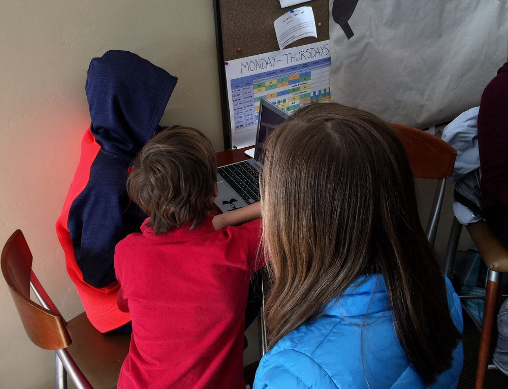 kids collaborating on their projects, using  actionlab360