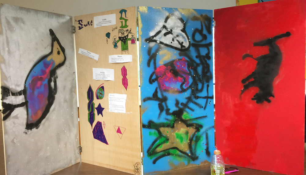decorations done by the kids in gypsum for their graffiti project