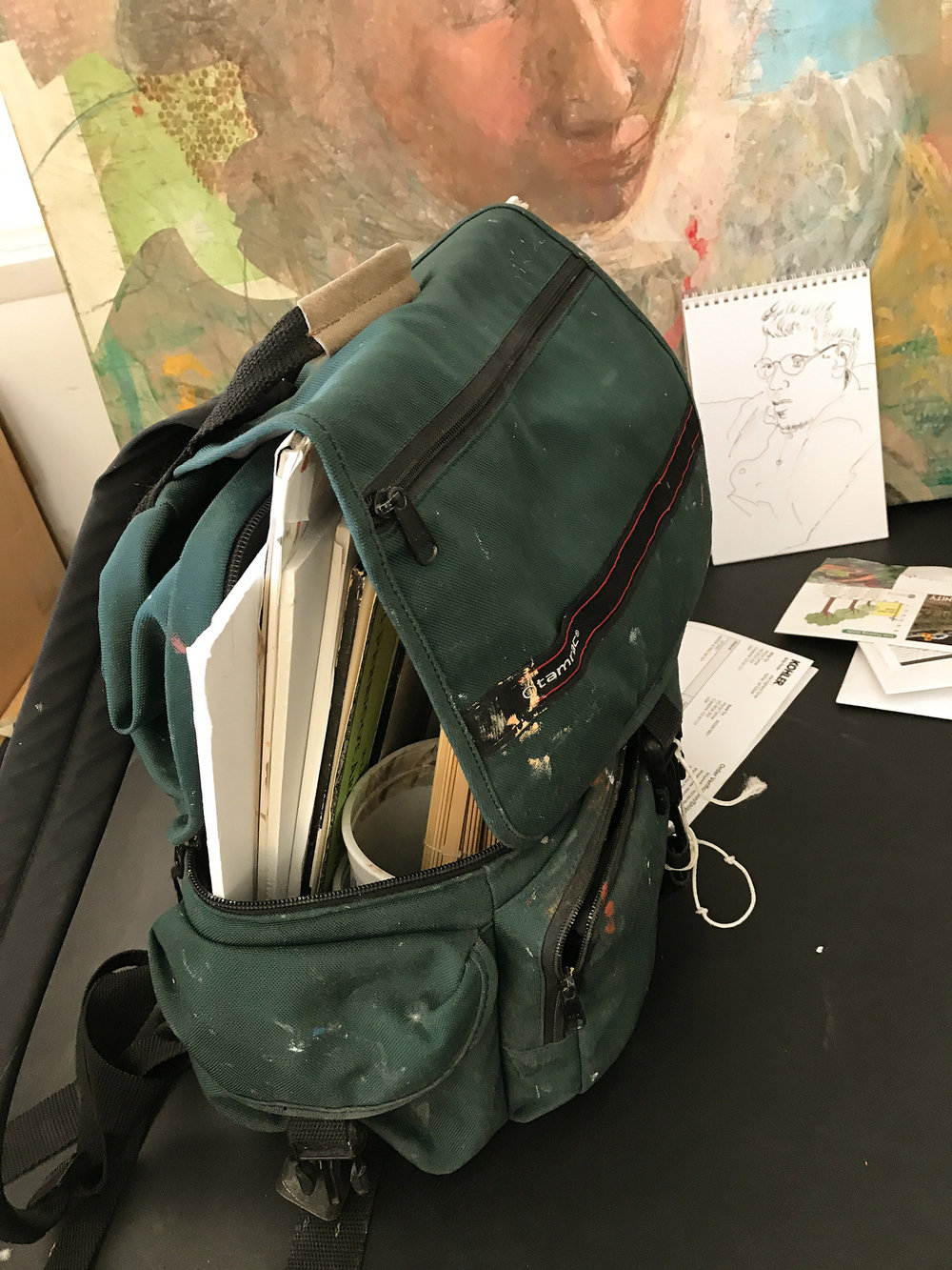my plein air backpack, with gouache colors, brushes, water container, paper & palette