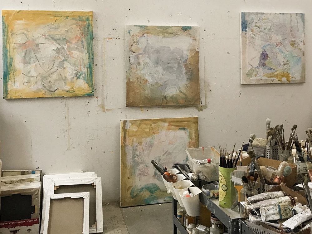 studio view at the end of my painting day, with  purple rock  on the right & 3 painted over motion paintings