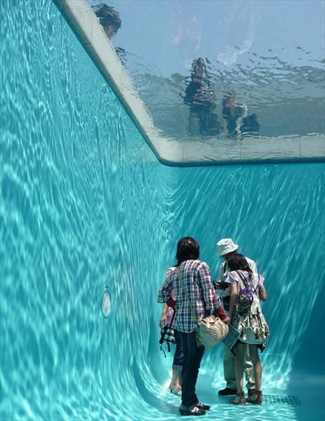 "Fake Pool via  AnOther | Loves       http://www.design-magazine.it/CuriositA/Simulated-Swimming-Pool.html:    ""Argentinian artist Leandro Erlich created this fake pool called The  Swimming Pool, for The 21st Century Museum of Contemporary Art in  Kanazawa, Japan. Leandro put two clear acrylic glasses about a foot  apart and filled the space in between with water. The top surface is  also filled with about 4 to 5 inches of water so that it looks like a  realistic pool."""