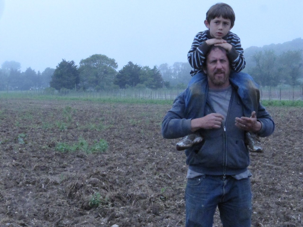 Farmer Chris Kaplan-Walbrecht and his son Forest giving us Brooklyn hipsters a tour of their lovely farm, Garden of Eve, in Riverhead, NY, May 2011    Forest knows  EVERYTHING  about the farm and all the organisms that abide there. The scope and breadth of his knowledge at 7 years of age is humbling/disarming.   Also, Garden of Eve = Best name for a farm  EVER.  Yeah, I'm biased, so what!