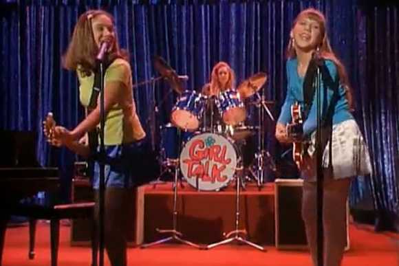 "Stephanie's band "" Girl Talk"" flames out while covering "" The Sign"" by Ace of Base at Uncle Jesse's Smash Club."