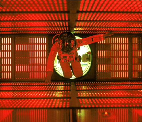 2001: A Space Odyssey (1968)    Dir: Stanley Kubrick    I love this still photo so much, it was my last desktop wallpaper, for 2 years.    If you, like me, find yourself throwing out the adjective 'kubrickian', more often than it's acceptable in polite society, do yourself a HUGE favor and check out this wonderful blog post by Double O'Nothing on the Production Design for 2001. It's succinct but informative!   http://doubleonothing.wordpress.com/2010/09/28/designing-the-future-the-production-design-of-2001-a-space-odyssey/