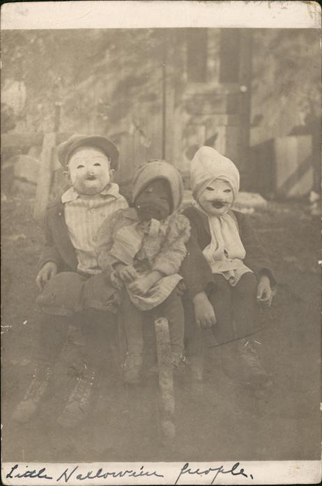"""Little Halloween People"": Victorian children in papier mâché masks for Old Hallows Eve."
