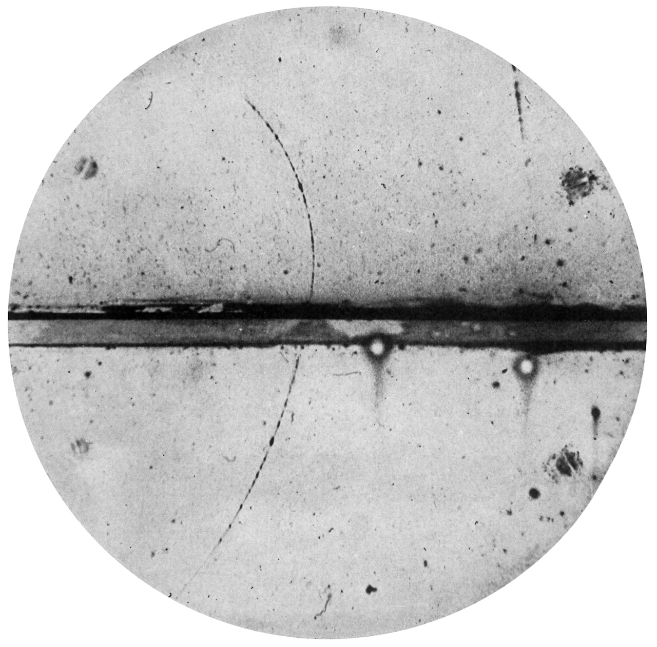 rudygodinez :      Carl D. Anderson,  Positive Electron , (1933)    The above image is a cloud chamber photograph of the first positive electron (positron) ever observed.    The original caption on the photograph reads as follows:     A 63 million volt positron (  H    ρ     = 2.1×10   5    gauss-cm) passing through a 6mm lead plate and emerging as a 23 million volt positron (  H    ρ     = 7.5×10   4    gauss-cm). The length of this latter path is at least ten times greater than the possible length of a proton path of this curvature.     First published in the  Physical Review  in March 1933.