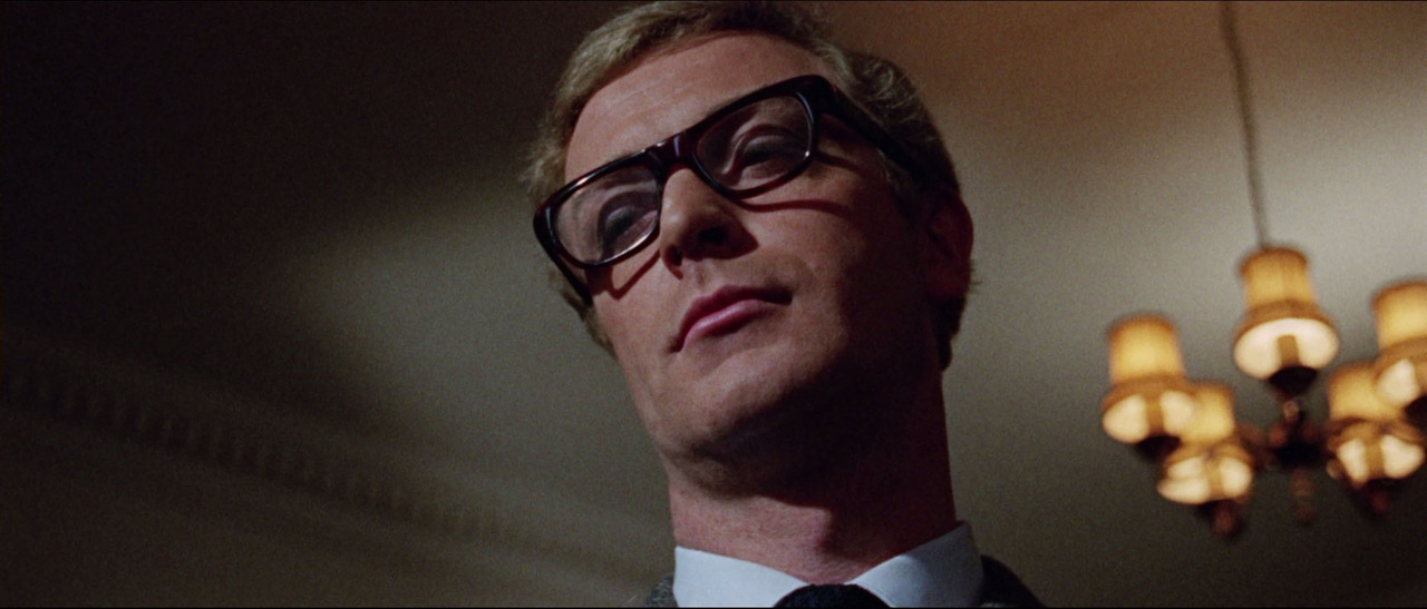 "SWEET FRAMES,  SIR MICHAEL CAINE!     1965 : As spy  Harry Palmer in The Ipcress File , tortoise-shell paste curved rectangular glasses.  Style:   ""Yvan"" by Curry & Paxton, Ltd. of London . Inspiration:  ""Teviot 74"" by UK Optical. (   Source   )    Throughout the last 50 years, Michael Caine has served the world thousands of his signature super cool/blasé glances. The best ones, have been amplified by one of the plethora of rad spectacles he has sported throughout his life. So, I've decided to have a weekly feature, entitled  ""Sweet frames, Michael Caine!""  As someone who has needed to wear corrective glasses practically all of my life, I'm inspired and empowered to accept my refractive issues by those who seriously look amazing in their frames.  Thanks,  Four-Eyes Caine …    About the frame:   This guy  has cool trivia about the Harry Palmer movies.  Maybe true, maybe not: still interesting.  It includes that although the actual frames sold at auction probably were custom, they were fashioned after  an inexpensive model that, although not free of charge under the National Health System coverage, could be fitted with the free standard-issue lenses.  He also claims, MC broke 3 pairs of glasses during production of Ipcress File; and, the Harry Palmer is the first lead character in an action film to wear glasses. Badass.     Those socialists from the Sixties, they thought they were so cool with their cool cheap glasses. I'd rather take my vast choice of 4 private-insurance covered models: the leisurely  ""Morty Seinfelds,  the thrifty  ""Frank Constanzas,""  the utilitarian "" Dwight Shrutes""   or the flirty "" Dawn Weiners "" any day, because that's what freedom is all about.   Stay tuned for next Monday's installment!"