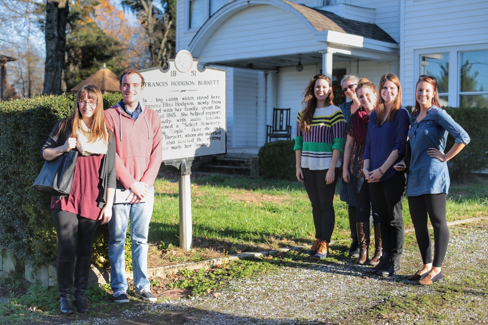 All seven students in front of Frances Hodgson Burnett's first American homesite in New Market, TN.