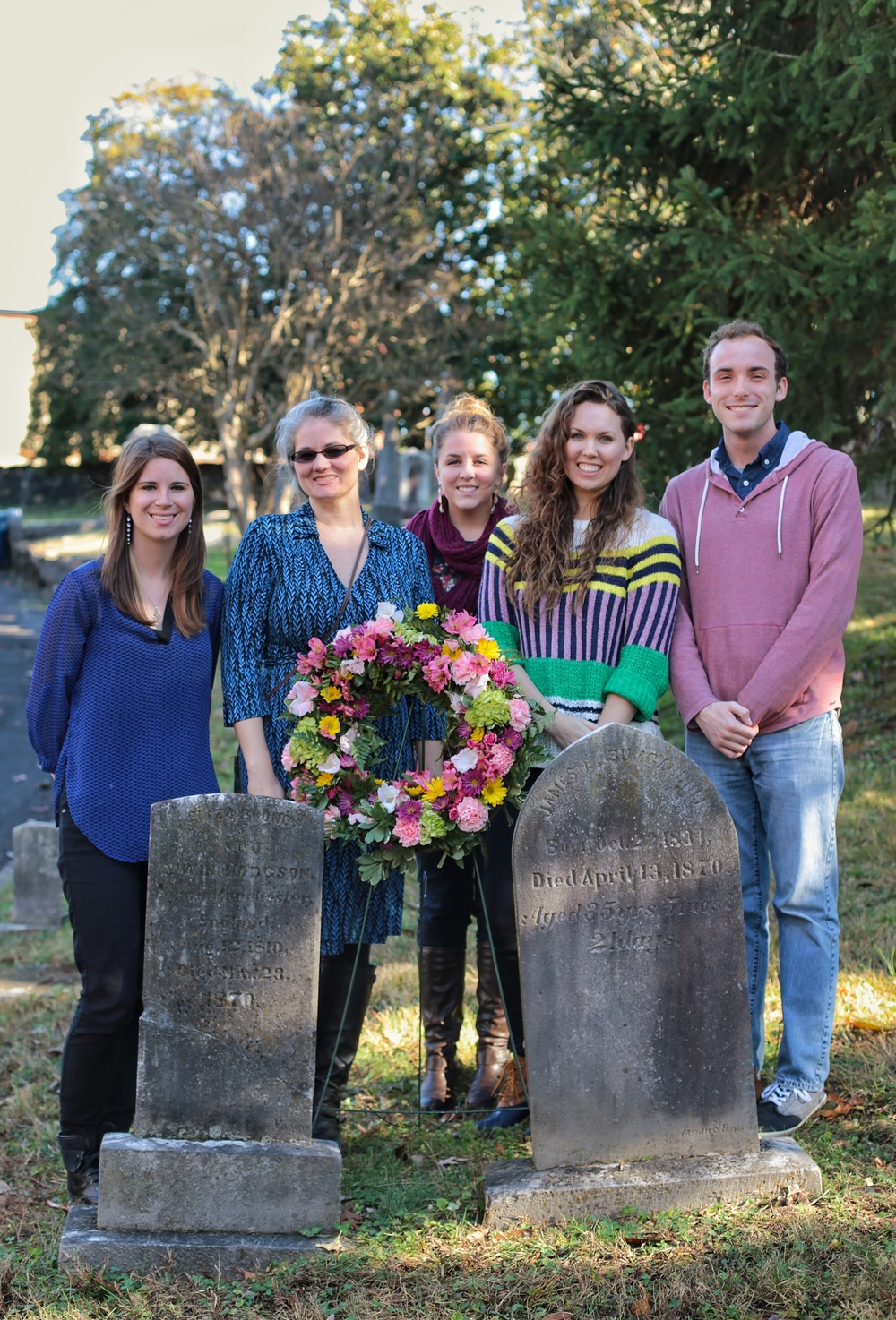 Five Lee University students at Eliza Boond Hodgson's grave, on the left. The wreath was placed there by fans and relatives of Burnett as part of the Frances Hodgson Burnett Sesquicentennial Celebration in November 2015.