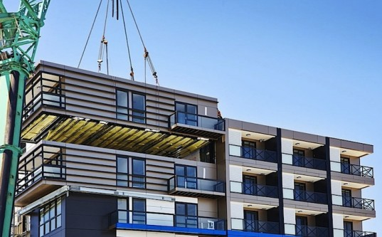 A Prefab module being installed.  Image via Hickory Group