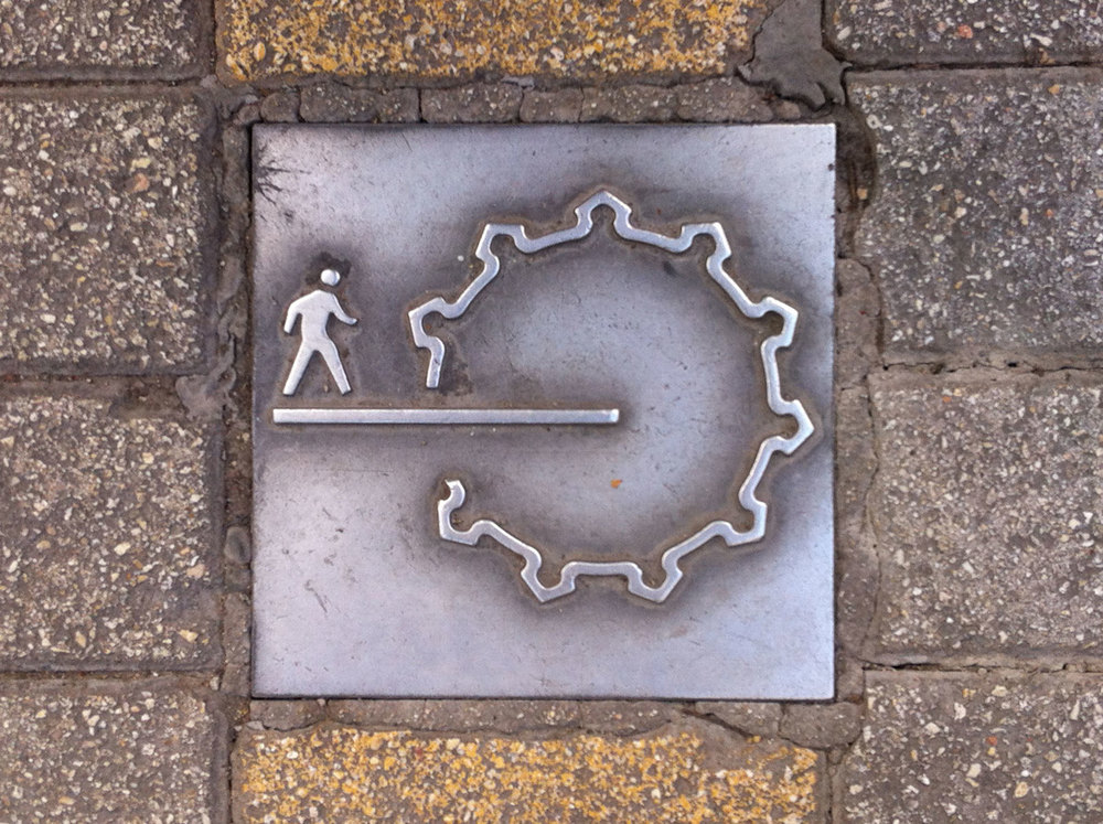 Nicosia walled city has been enhanced by a network of pedestrian streets marked by this symbol.