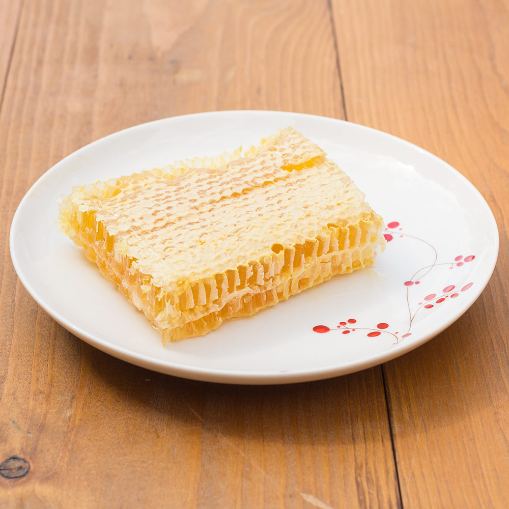 Cut comb honey leaves a wonderful taste in your mouth as the delicate wax melts away t a light sweet honey.