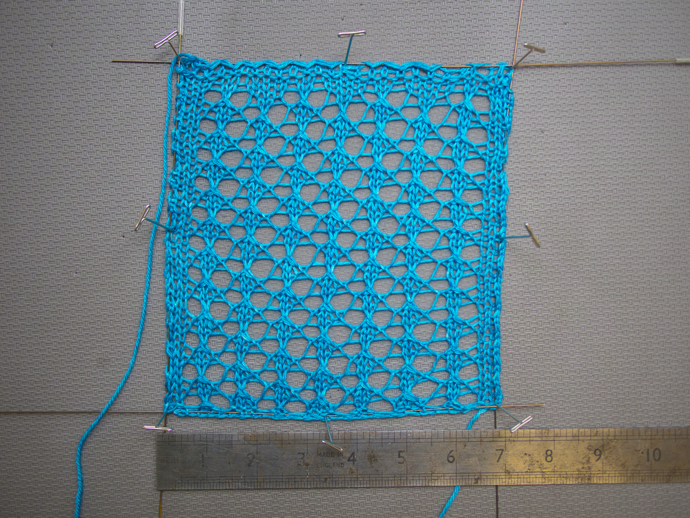 While blocking the swatch measures about 7""