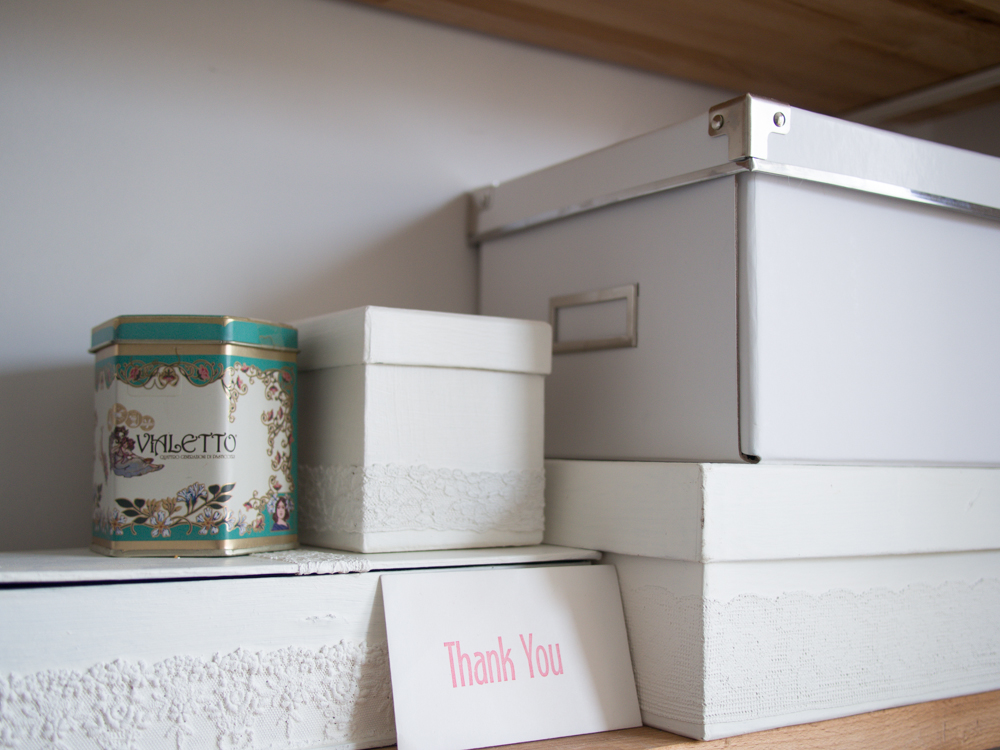 Boxes and tins for notions and supplies - lace glued to cardboard boxes and painted.