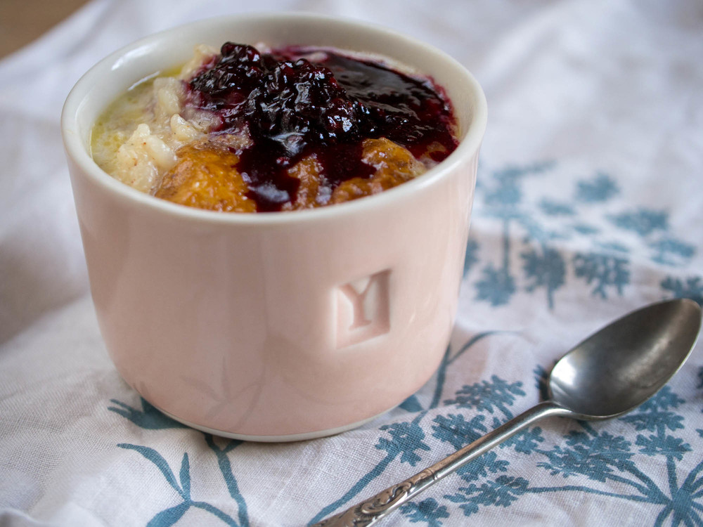 Cardamom rice pudding with bramble jam