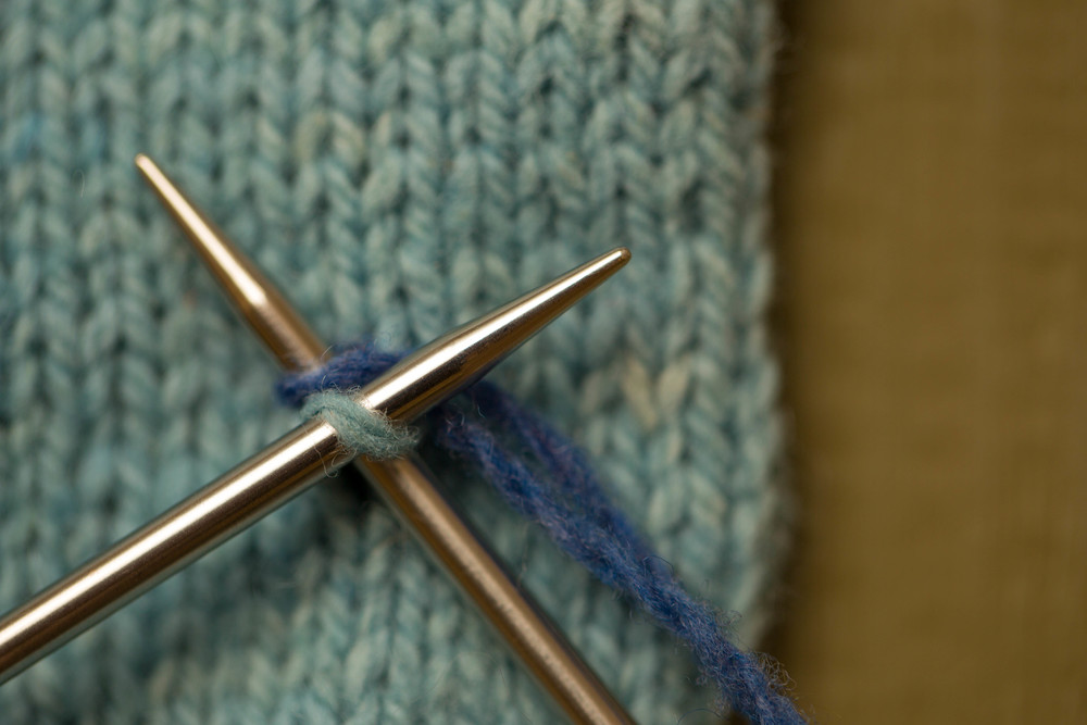 Insert right needle and knit the picked up loop.