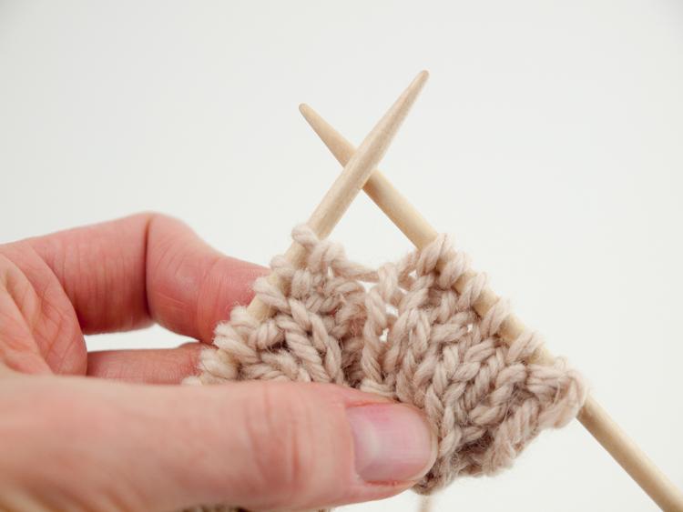 Knit the next stitch.