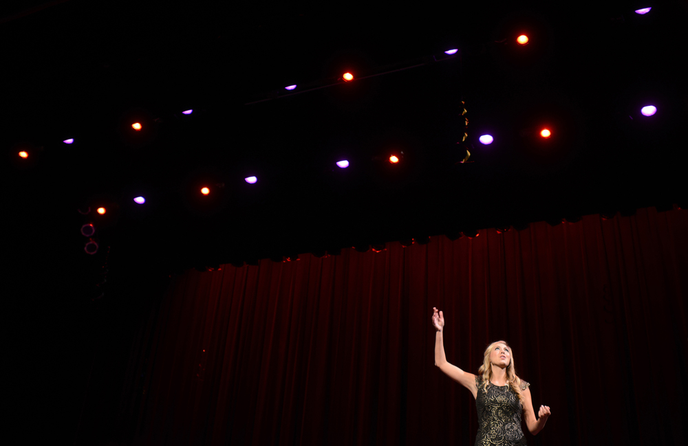 Performing her monologue.