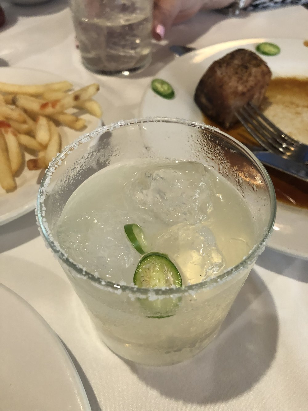 Natural margarita with a thin jalapeño slice.  Handily outperforms the watery jalapeño margarita  Blanco  Colima.