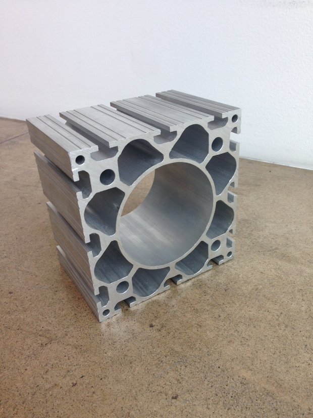 Extruded aluminum column segment. An extremely lightweight component designed for efficient prefab construction.