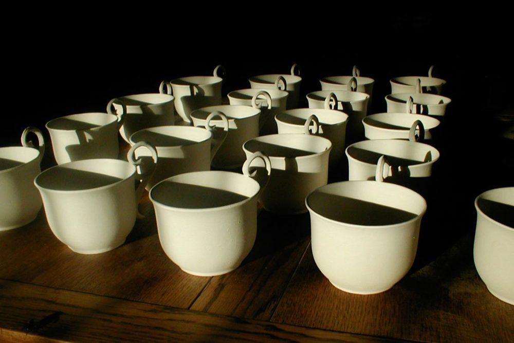Unfired bone china slip cast cups, created whilst on a residency in the disused buffet of Platform 1, Pontypridd.