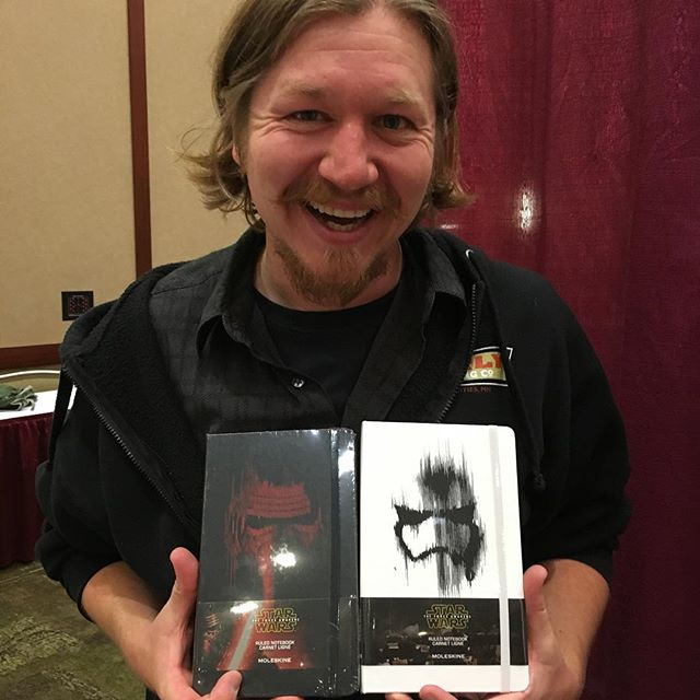We're unpacking the treasures for #heartlandfallforum2015. Ted found the new Star Wars: The Force Awakens Moleskines. And is excited.
