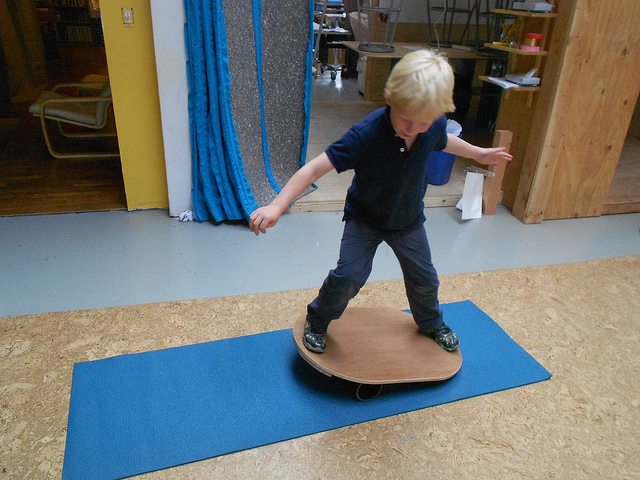 What is it like to be BOTH masses on the teeter-totter? Lincoln on the balance board.