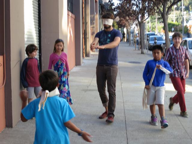 Nico coaches Josh down Bryant Street.